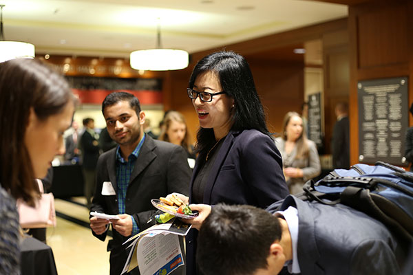 Students talking during a networking event.